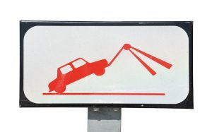 sign of a truck towing a car
